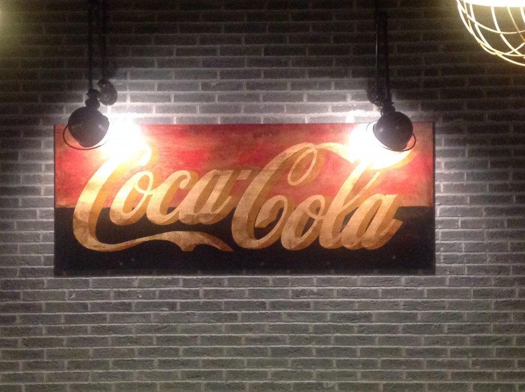 Black and Red Coca Cola Logo Sign